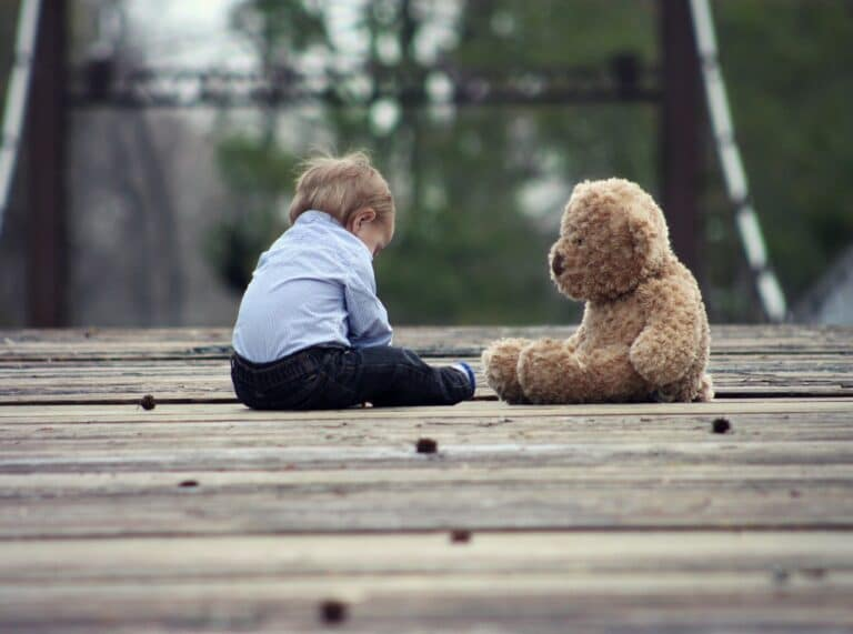 Picture of child sitting with a teddy